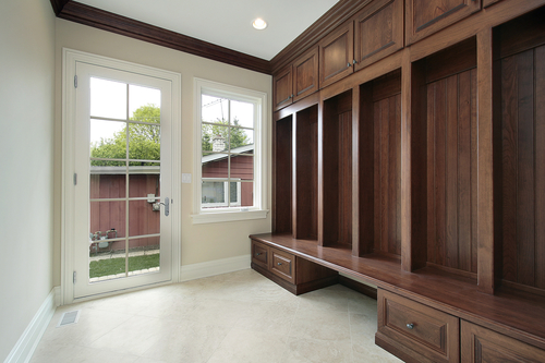 Basement Mudroom with wood cabinetry
